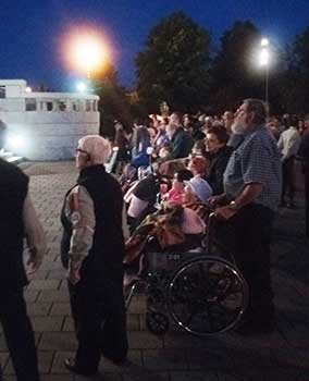 People in wheelchairs at the candlelight procession